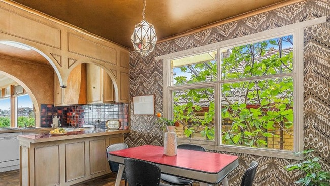 All the original 1970s finishes remain intact including tiger print wallpaper. Picture: Supplied