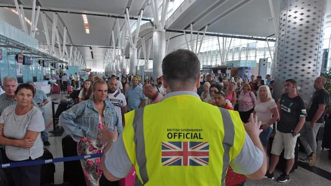 British government officials addressed crowds of tourists at the Enfidha International airport in Tunis. Picture: Fethi Belaid/AFP