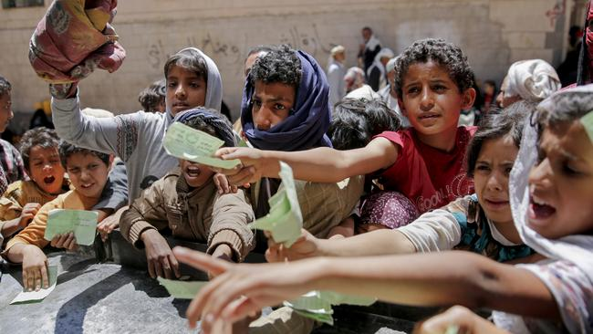 Yemenis present documents in order to receive food rations provided by a local charity, in Sanaa, Yemen, Thursday, April, 13, 2017. A Saudi-led coalition launched a campaign in support of Yemen's internationally recognised government in March 2015. The stalemated war has pushed the Arab world's poorest country to the brink of famine. Picture: AP /Hani Mohammed.