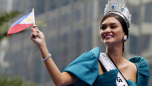 Thousands of people turned out to see the new Ms Universe. AP Photo/Bullit Marquez)