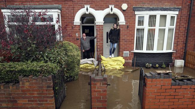 Residents in Yarborough Terrace look out at the flood water from their houses in Doncaster. Picture: AP