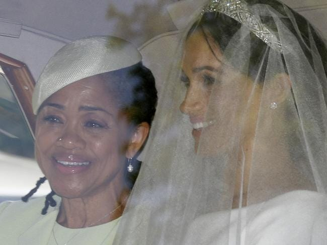 Meghan's dress was spotted through the car window. Picture: AP Photo/Tim Ireland.
