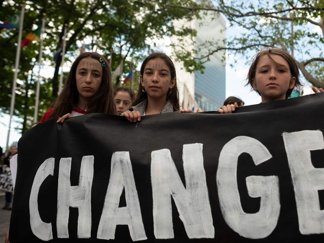Schoolchildren hold a placard reading 'CHANGE' during the Youth Climate Strike on May 24 outside United Nations headquarters in New York City. Picture: Johannes Eisele/AFP