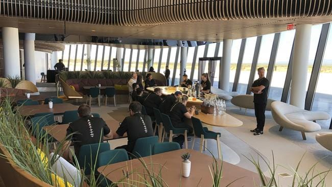 Virgin Galactic employees gather in the ground floor lounge at Spaceport America. Picture: AP/Susan Montoya Bryan