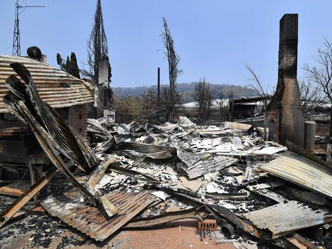 A burnt house is seen after bushfire in Batlow, NSW. Picture: Saeed KHAN/AFP