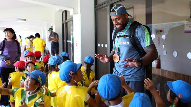 Samu Kerevi of Australia high fives local children following training at Odawara Stadium.