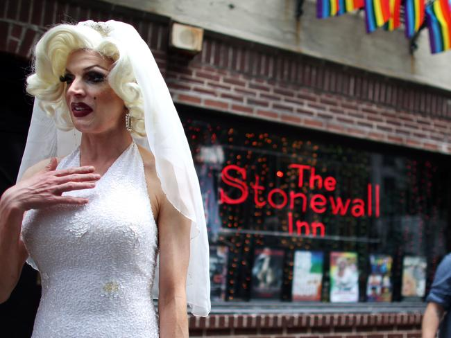 Wedding bells ... Carlotta Gurl, a gay rights activist from Vancouver, Canada, chats outside of the Stonewall Inn, the bar where many say the gay rights movement started. Picture: AFP