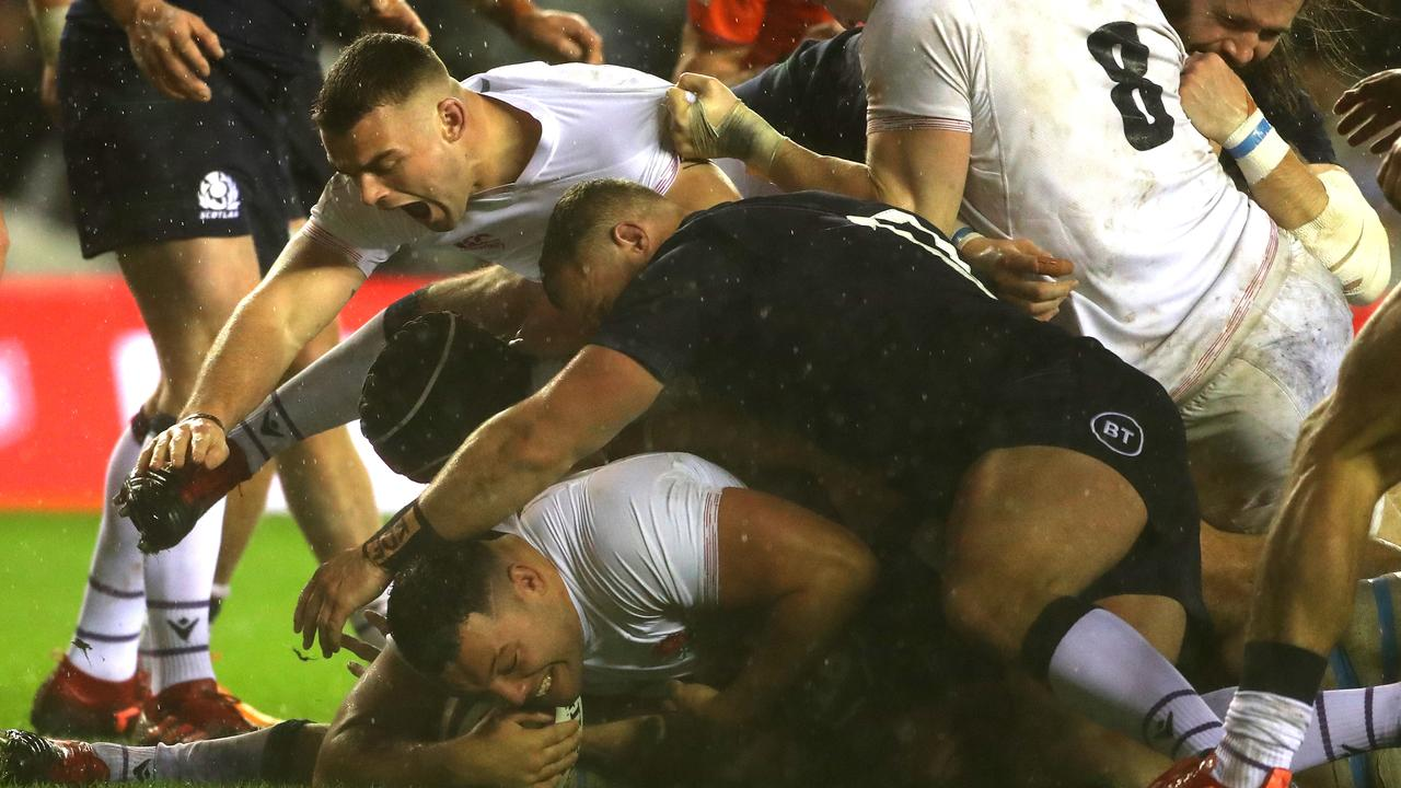 Ellis Genge dives over to score the match winning try for England against Scotland.