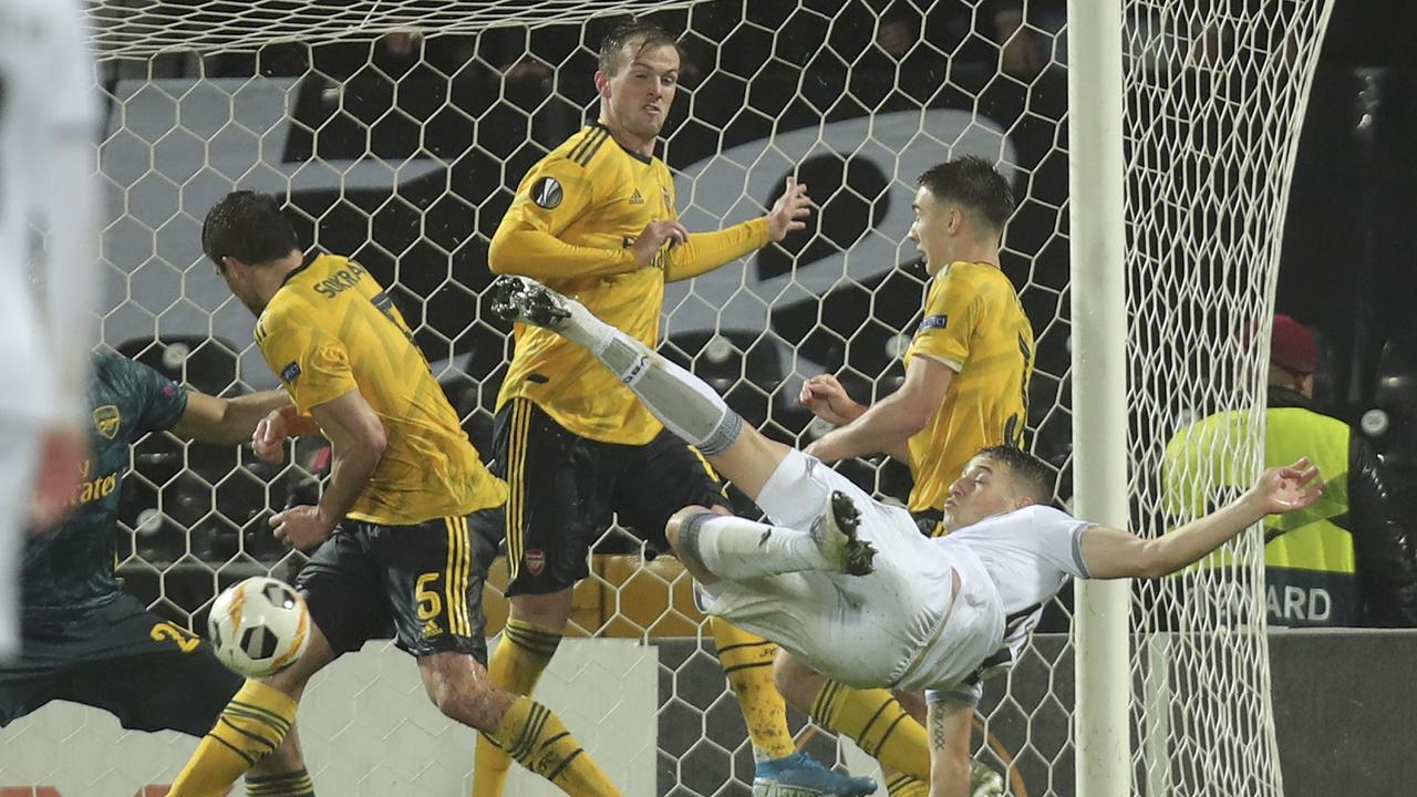 Arsenal conceded an acrobatic late goal to hand Vitoria their first point in the Europa League.
