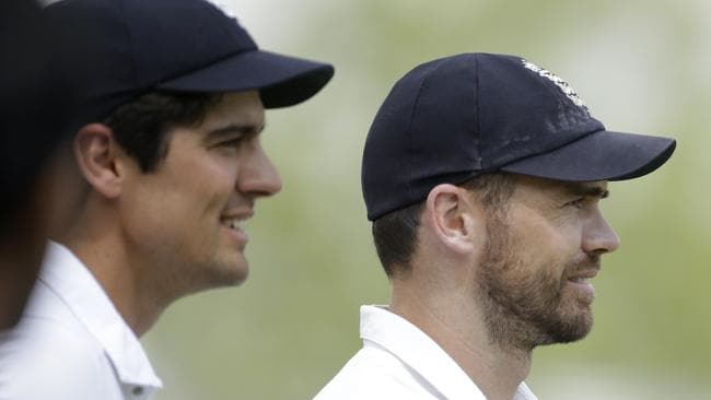 England's captain Alastair Cook, left, gives a congratulatory pat on the back to James Anderson.