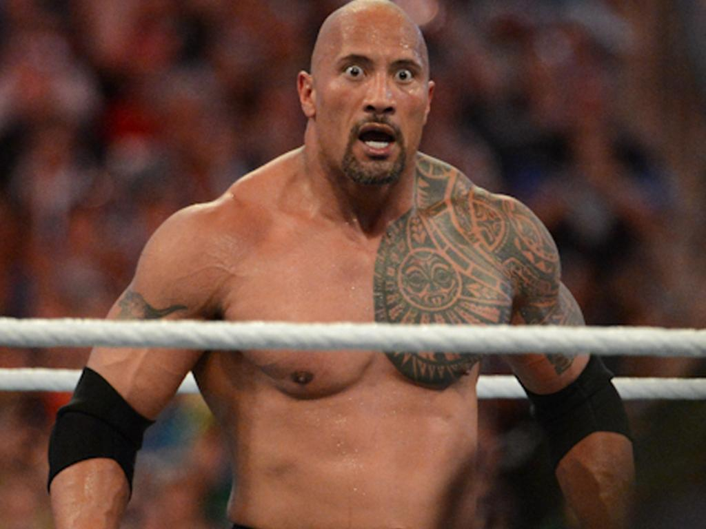 MIAMI GARDENS, FL - APRIL 1: Dwayne ''The Rock'' Johnson looks on during his match against John Cena during WrestleMania XXVIII at Sun Life Stadium on April 1, 2012 in Miami Gardens, Florida. (Photo by Ron Elkman/Sports Imagery/Getty Images)