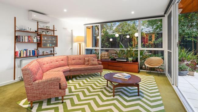 Three zoned living areas are found across the split-level home.