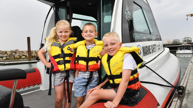 Bella, 6, Henry, 4, and Harry, 9, safe in their life jackets at the West Beach boat ramp. picture: AAP / Keryn Stevens