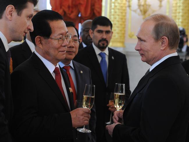 Mingling...Putin greets North Korean Ambassador Kim Hyun-joon. Picture: AP Photo/RIA-Novosti, Mikhail Klimentyev, Presidential Press Service