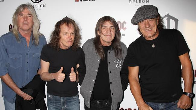 End of era ... Malcolm Young (third from left) with his AC/DC bandmates. Picture: Chris Jackson