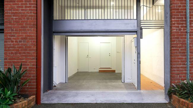 Entry through the remote-controlled garage at 4/120 Queens Pde.