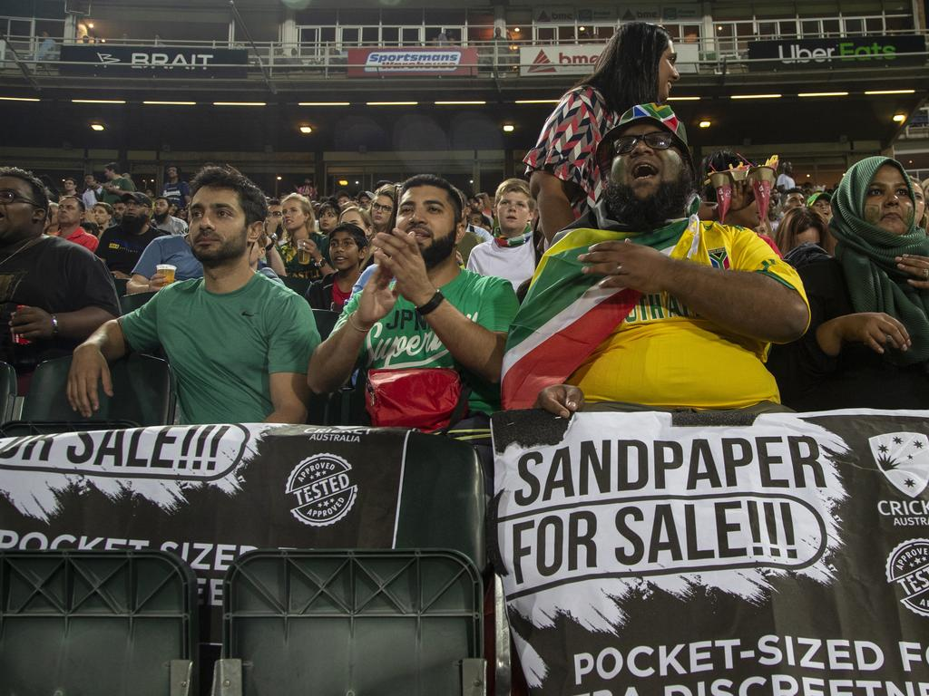 Fans hold posters during the 1st T20 cricket match between South Africa and Australia at Wanderers stadium in Johannesburg, South Africa, Friday, Feb. 21, 2020. (AP Photo/Themba Hadebe)