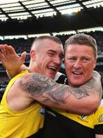 The Tiger's Dustin Martin and coach Damien Hardwick celebrate after the final siren after Richmond defeated the Adelaide Crows in the 2017 AFL Grand Final at the MCG. Picture. Phil Hillyard