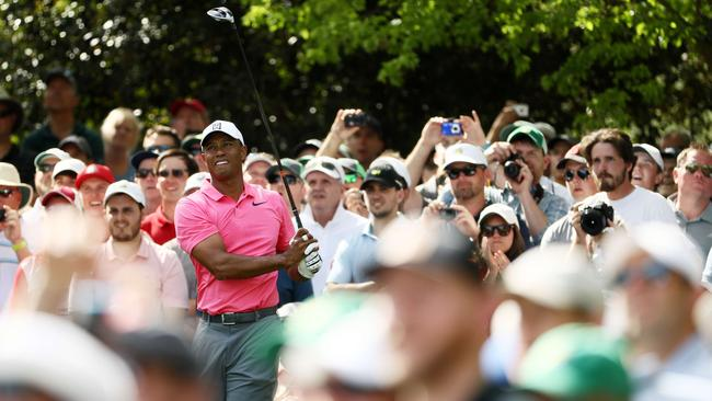 Tiger Woods plays a shot on the seventh hole during practice for the Masters.
