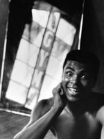 """A picture from the book, """"Muhammed Ali: The Birth of a Legend"""" showing the boxer as a young man."""