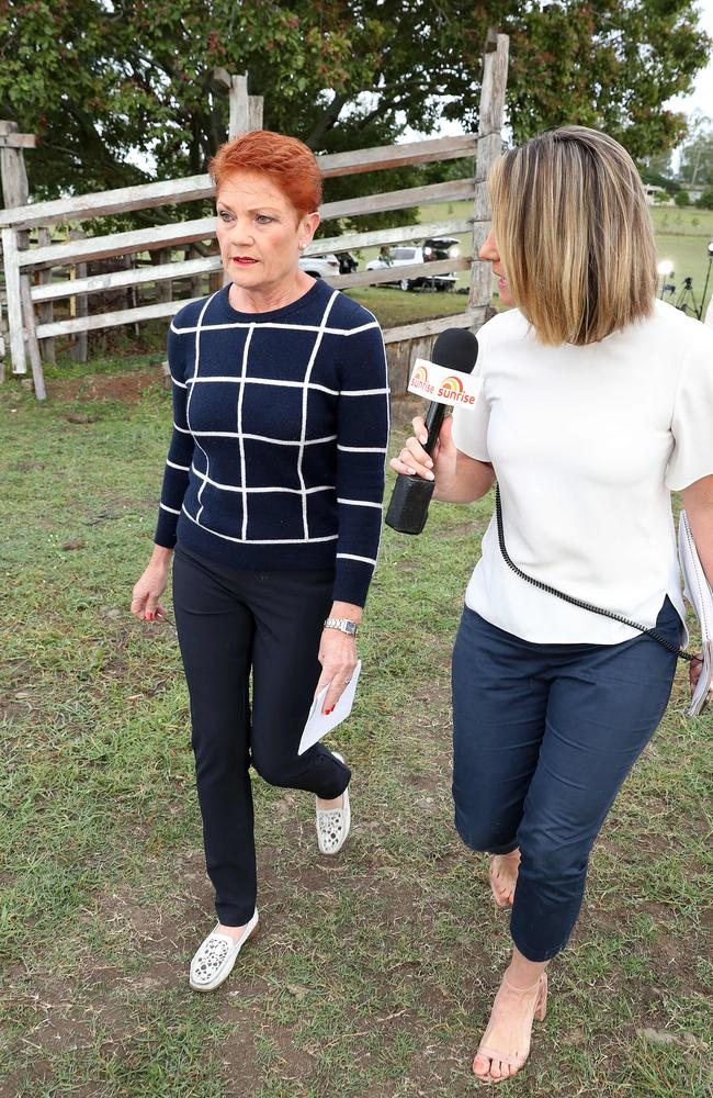 Pauline Hanson flees from reporters after a media conference. Picture: Liam Kidston.