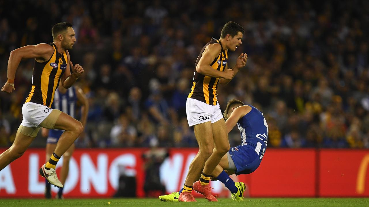 Shaun Higgins falls to the ground after being knocked unconscious by Ryan Burton. Photo: AAP Image/Julian Smith