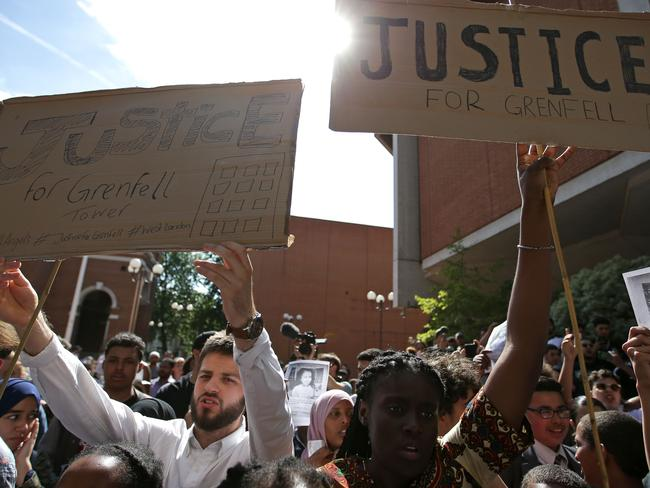 People gather outside Kensington Town Hall to demand justice for those affected by the fire that gutted Grenfell Tower. picture: AFP