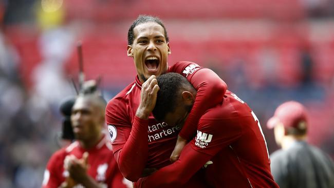 Virgil van Dijk of Liverpool celebrates victory with Georginio Wijnaldum