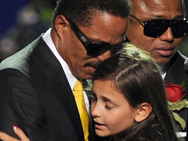 Michael Jackson's daughter Paris is comforted by her uncle Marlon Jackson at a memorial service for the music legend in 2009. Picture: AFP