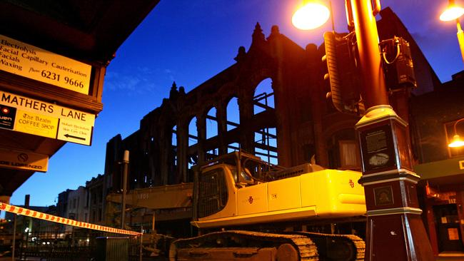 Heavy machinery waits to begin the demolition of the Myer building after the devastating blaze.
