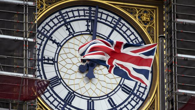 A Union flag waves against the backdrop of the clock facade of the Elizabeth Tower in London. Picture: AP/Alberto Pezzali
