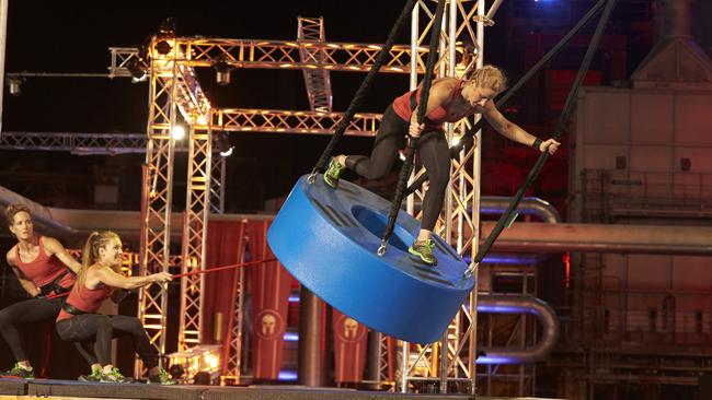 Contestants attempt the Tyre Swing on Australian Spartan. Picture: Channel 7