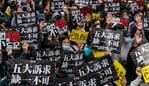 "HONG KONG, CHINA - JANUARY 1: Pro-democracy supporters hold placards and shout slogan as they take part in a march during a rally on New Years Day on January 1, 2020 in Hong Kong, China. Anti-government protesters in Hong Kong continue their demands for an independent inquiry into police brutality, the retraction of the word ""riot"" to describe the rallies, and genuine universal suffrage. (Photo by Anthony Kwan/Getty Images)"