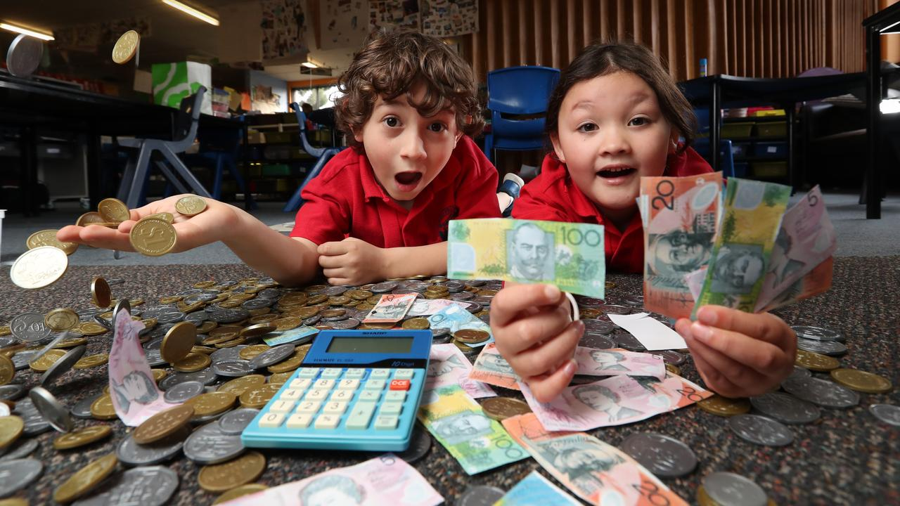 Richmond Primary School students Jordy and Mai are learning about cash using coins and notes for a pretend supermarket. Picture: Alex Coppel