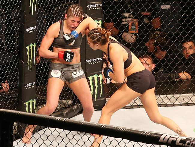 Alex Chambers on the back foot in her UFC bout with Kailin Curran (black shorts). Picture Sarah Reed