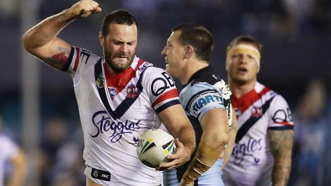 Boyd Cordner of the Roosters celebrates as Paul Gallen of the Sharks is penalised.