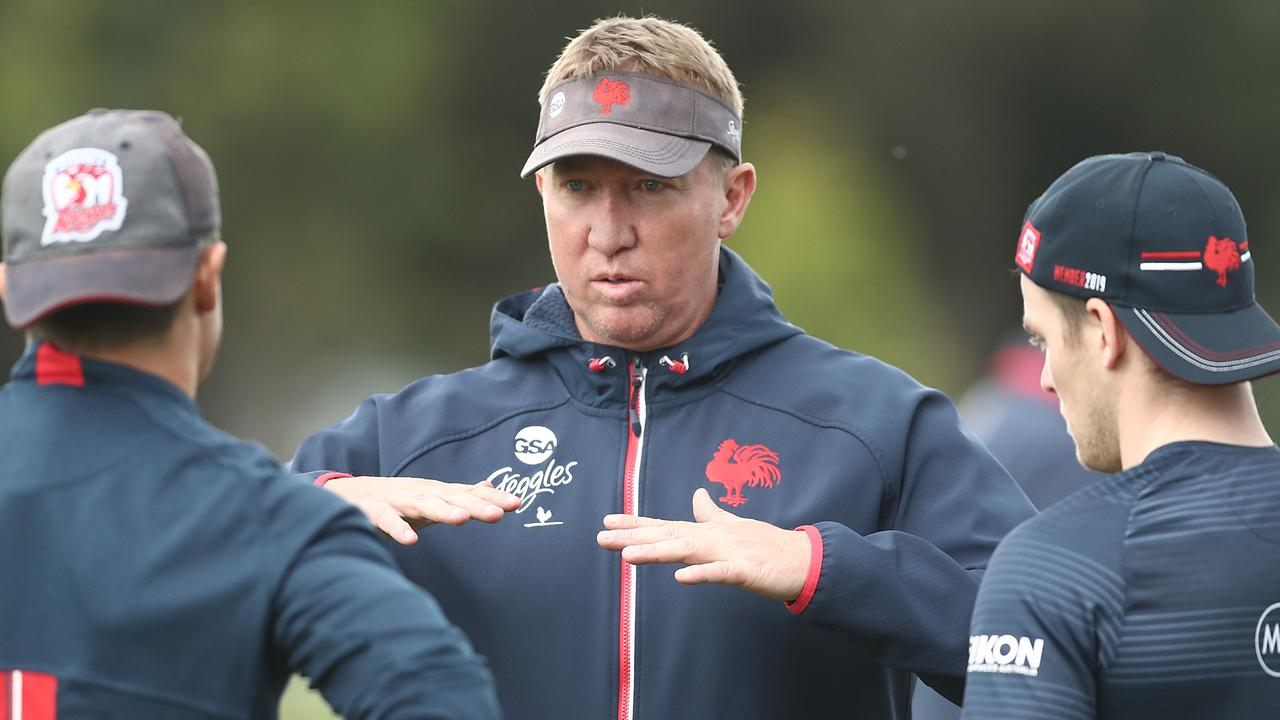 Roosters coach Trent Robinson talks to Cooper Cronk and Luke Keary during last season.