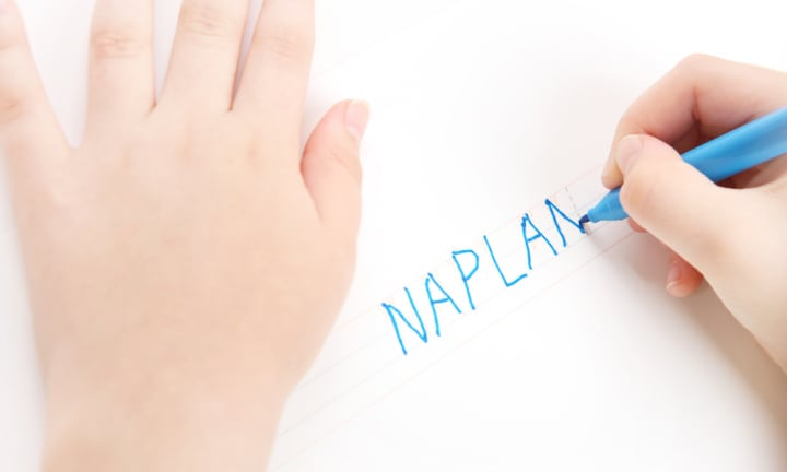 Naplan is an Australian Standardised Test that most school children go through. In this image, preschool child tracing the word NAPLAN. Font used for tracing is my own design,