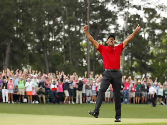 Woods celebrates his fifth US Masters win.