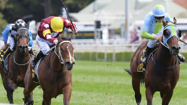 Ragged Rascal (right) scored an upset win in the Heritage Stakes. Picture: AAP