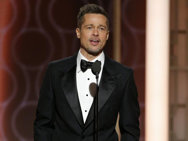 Brad Pitt just being handsome and stuff at the 74th Golden Globe Awards at The Beverly Hilton Hotel.