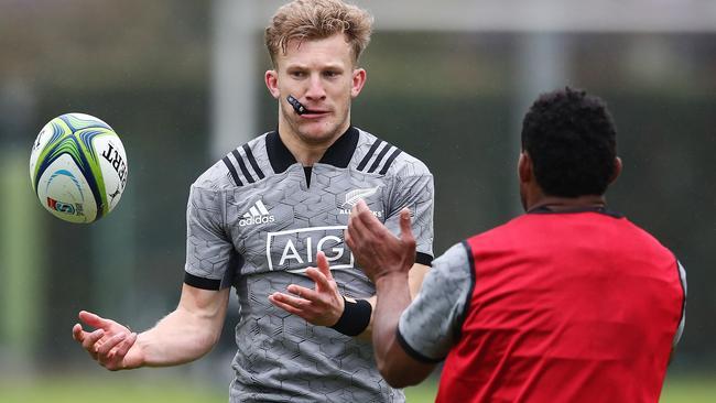 Damian McKenzie runs through drills during an All Blacks training session in Tokyo.