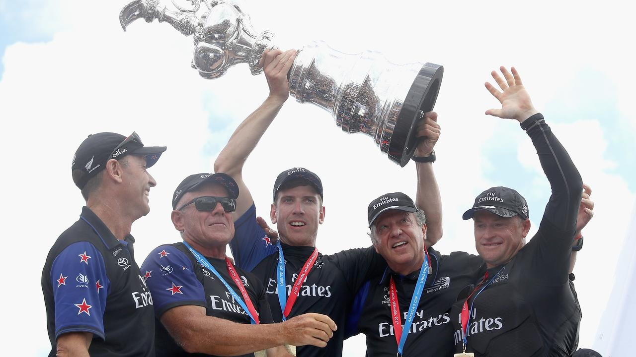 Chief Operating Officer Kevin Shoebridge, CEO Grant Dalton, helmsman Peter Burling, team principal Matteo de Nora and skipper Glenn Ashby lift the trophy as Emirates Team New Zealand win race 9 against Oracle Team USA to win the America's Cup on day 5 of the America's Cup Match Presented by Louis Vuitton on June 26, 2017 in Hamilton, Bermuda. (Photo by Clive Mason/Getty Images)