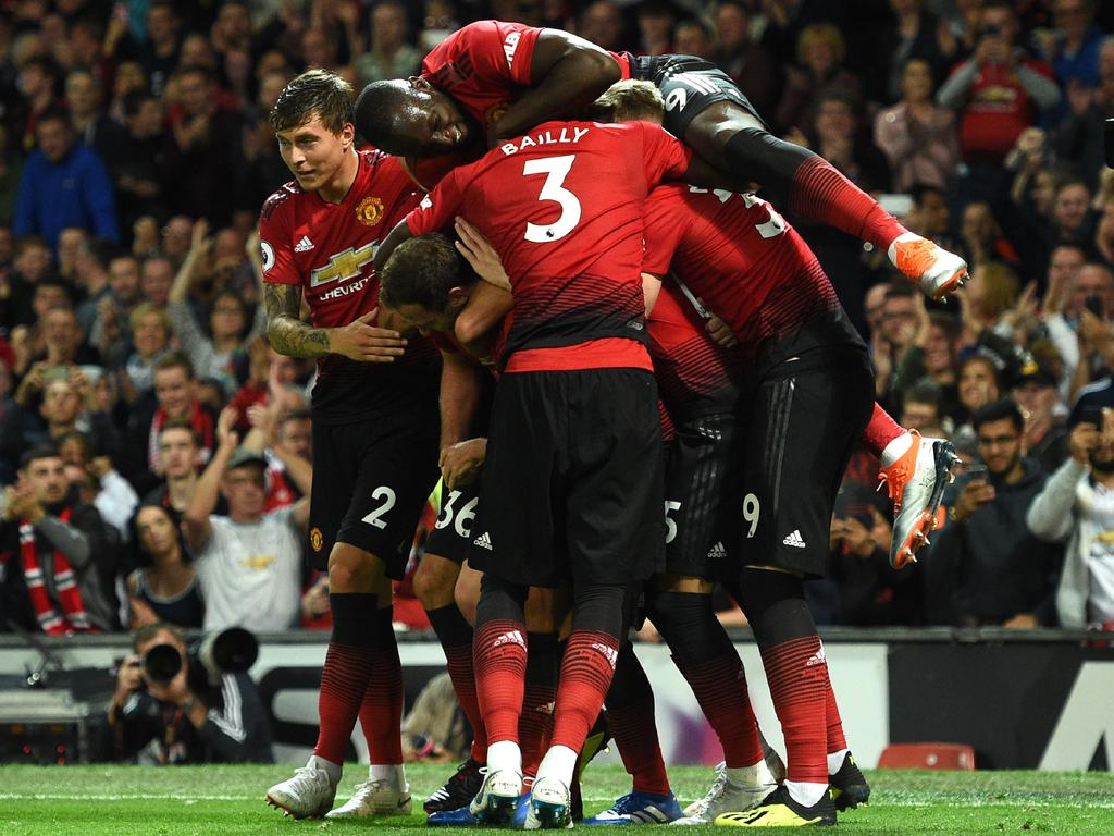Luke Shaw is swamped by teammates after scoring United's second. Picture: AFP