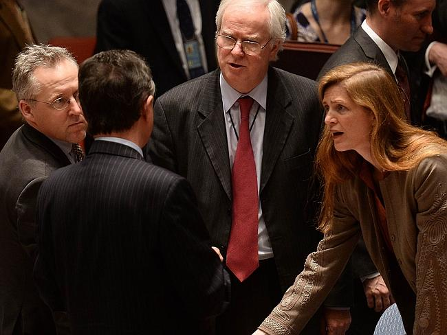 Tense times ... Ukrainian Ambassador to the UN Yuriy Sergeyev (second left) speaks with his US counterpart Samantha Power (right) and British counterpart Mark Lyall Grant (centre) after a vote on a draft resolution on Ukraine during a UN Security Council emergency meeting at the United Nations headquarters in New York. Picture: Emmanuel Dunand