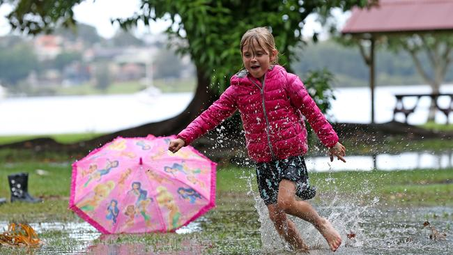 Sydney's rain is here to stay … Harper, 6, splashes around in a puddle in Rhodes this week. Picture: Toby Zerna