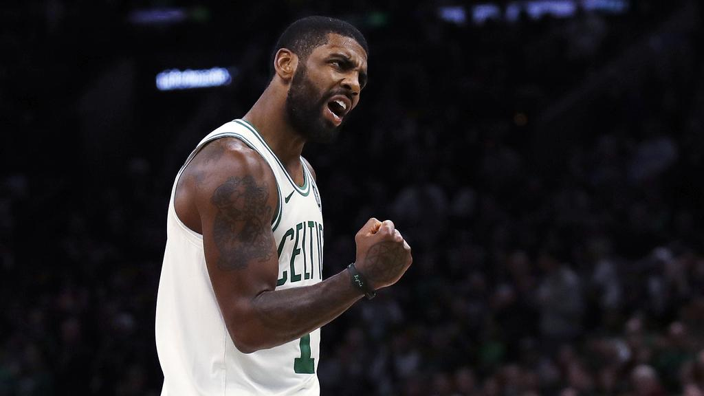 b63ff27c989 Boston Celtics guard Kyrie Irving pumps his fist during the second half of  the team s NBA