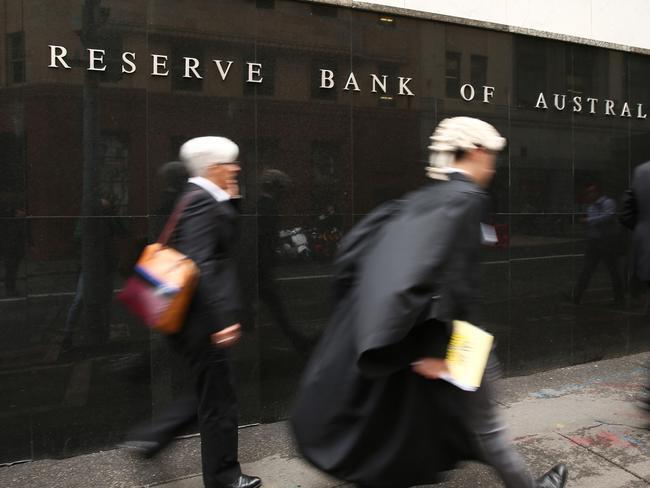 Pedestrians walk past the Reserve Bank of Australia headquarters in Sydney. Photographer: Brendon Thorne/Bloomberg