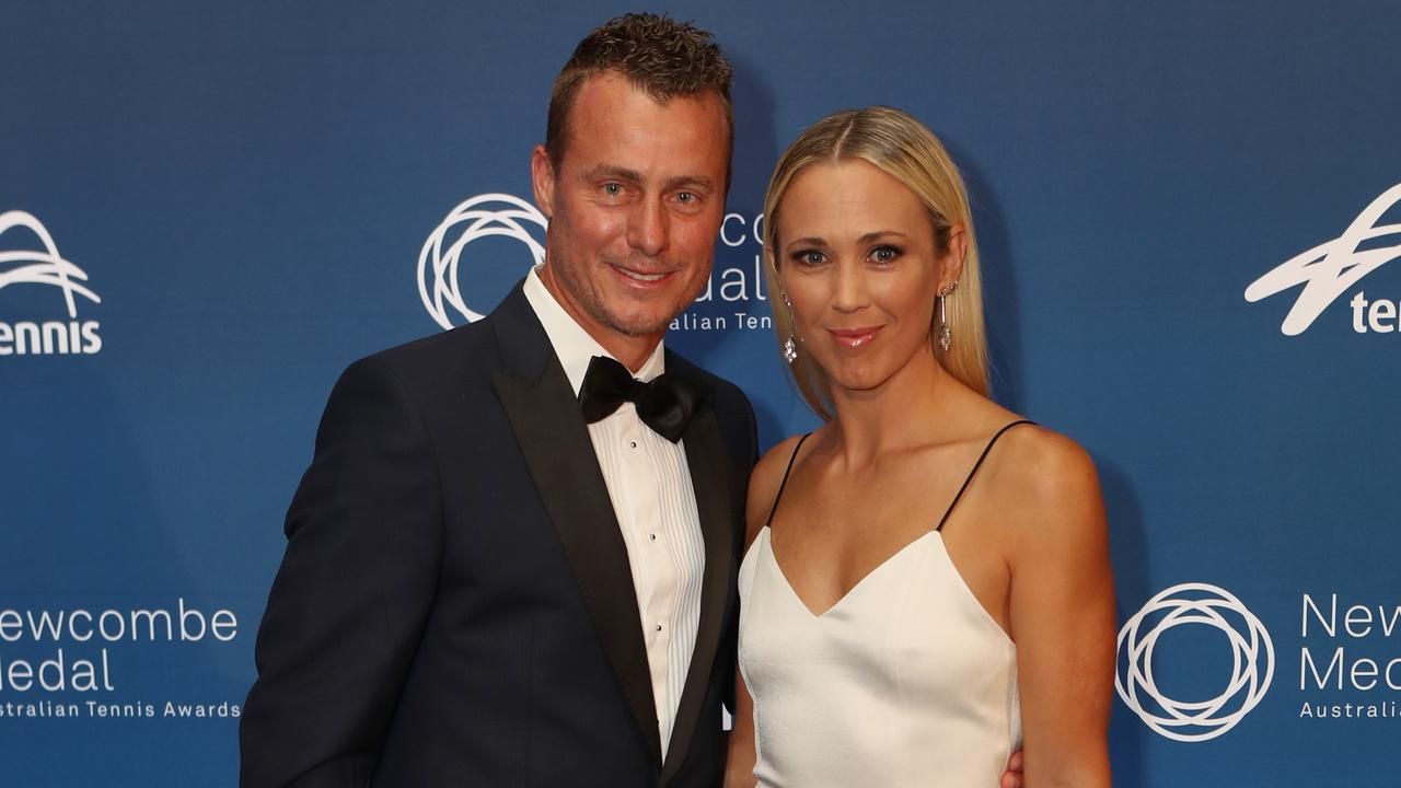 Lleyton Hewitt, pictured with wife Bec, said Tomic had threatened his family.