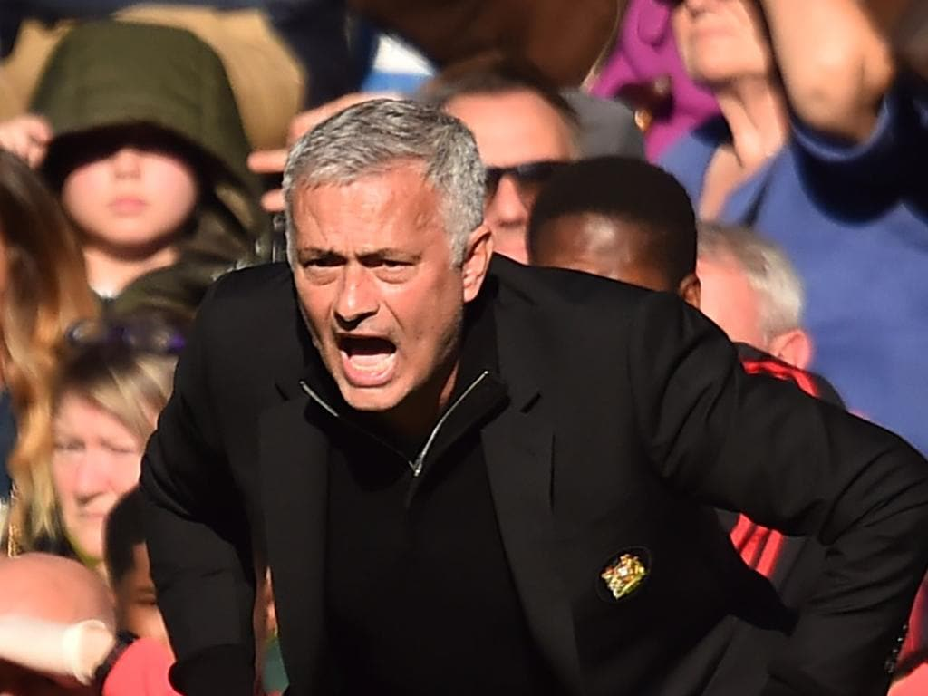 Manchester United's Portuguese manager Jose Mourinho gestures on the touchline during the English Premier League football match between Chelsea and Manchester United at Stamford Bridge in London on October 20, 2018. (Photo by Glyn KIRK / AFP) / RESTRICTED TO EDITORIAL USE. No use with unauthorized audio, video, data, fixture lists, club/league logos or 'live' services. Online in-match use limited to 120 images. An additional 40 images may be used in extra time. No video emulation. Social media in-match use limited to 120 images. An additional 40 images may be used in extra time. No use in betting publications, games or single club/league/player publications. /